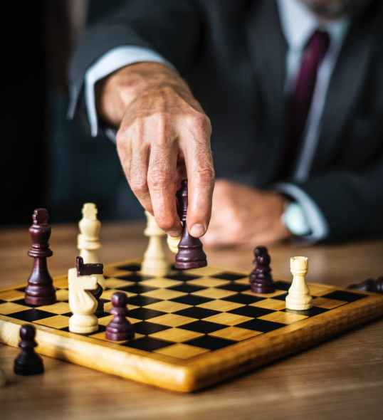 person holding chess toy
